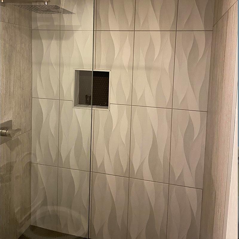 Glass and tile shower after bathroom remodel