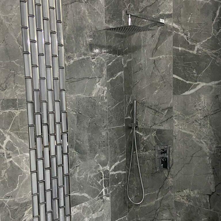 modern shower remodel with grey marbled tile